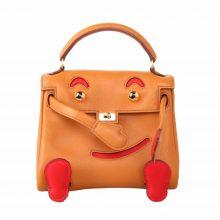 Hermès(爱马仕)kelly doll娃娃包 太妃金拼火焰红 swift皮 银扣 18cm