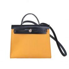 Hermès(爱马仕)Herbag 黑色盖头琥珀黄帆布 银扣 31cm